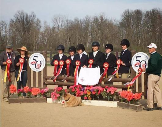 Purdue Equestrian Team at Regional Horse show holding ribbons.